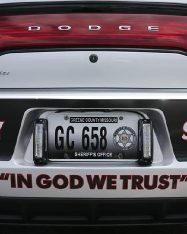 In God We Trust on a police car