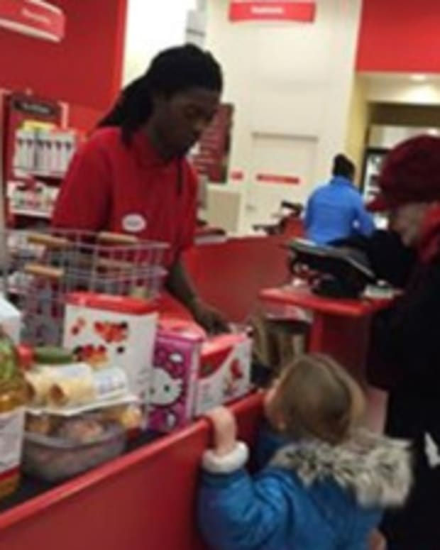 Target cashier helping elderly woman