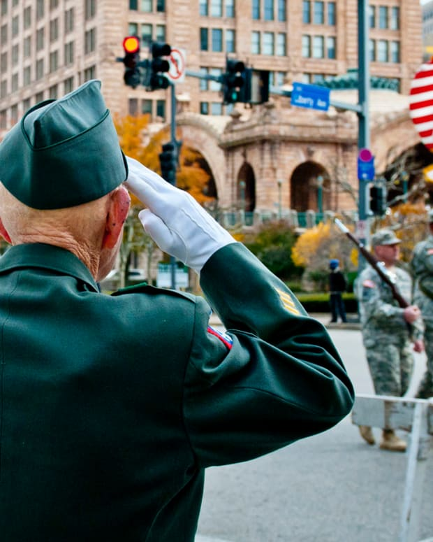 veteran salutes soldiers