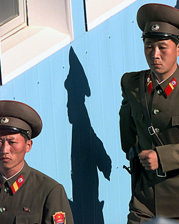 North Korean soldiers march during a ceremony