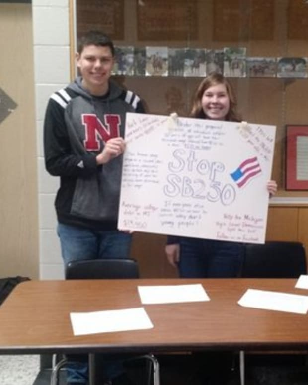 Students at Byron Center High School collect signatures against a bill proposing to lower the minimum wage for people under 20