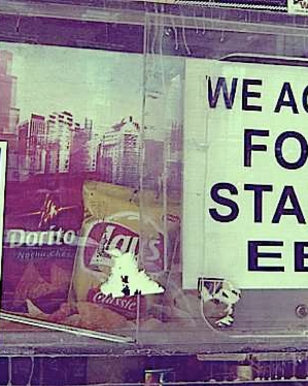 'We Accept Food Stamps EBT' sign