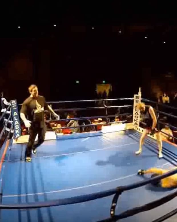 62-year-old Wayne delivers a spinning backfist to his MMA opponent