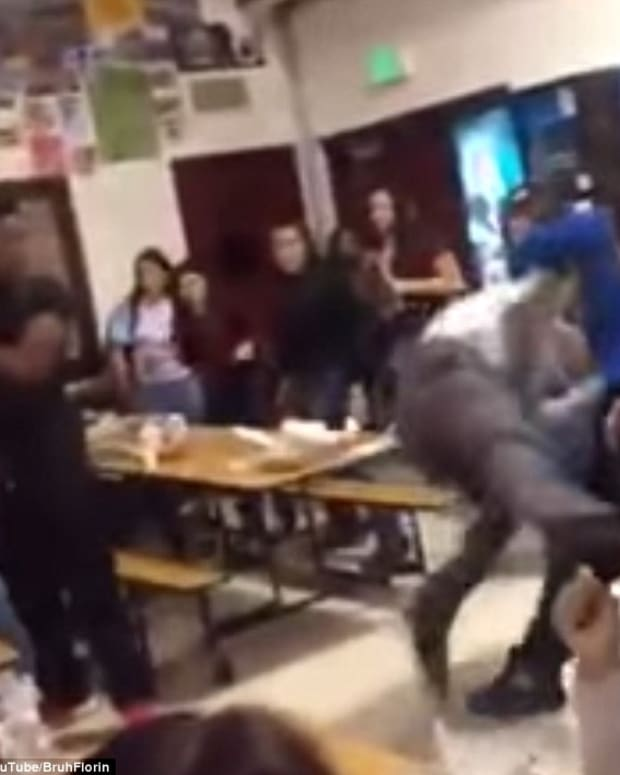 screenshot, teen body-slamming school principal