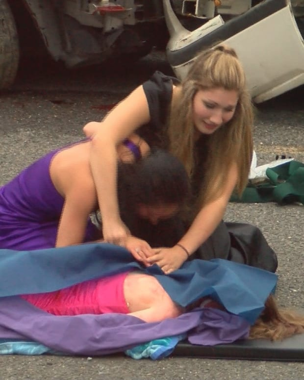 High School Puts On Mock Car Crash To Prevent DUIs Promo Image