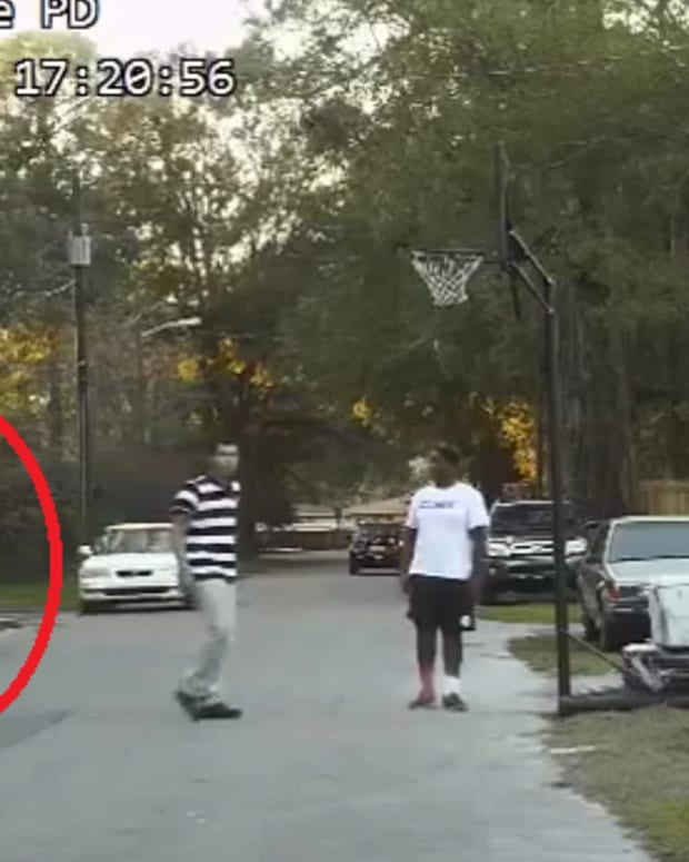 police officer playing basketball with kids