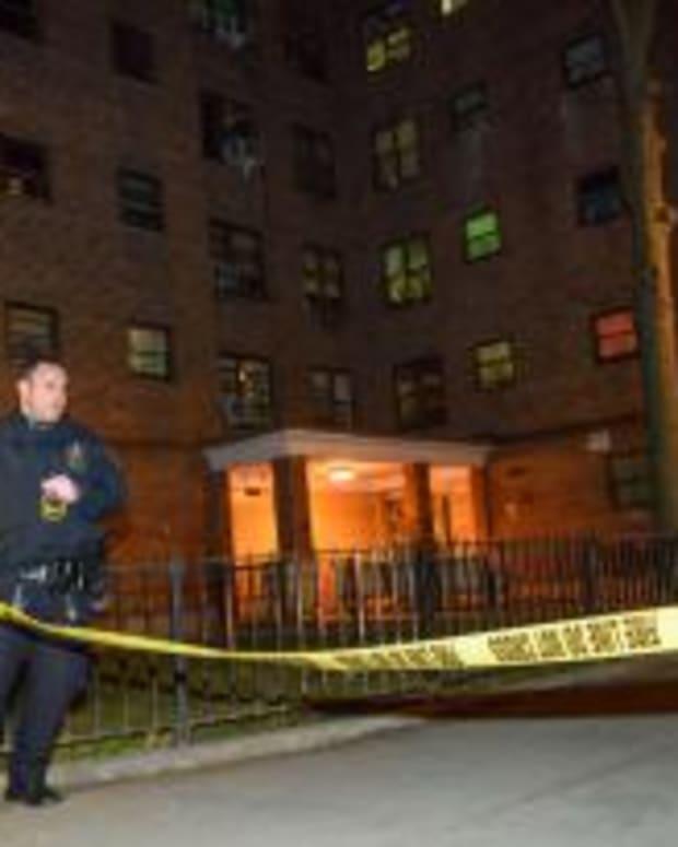 crime scene tape outside apartment building where bodies were found