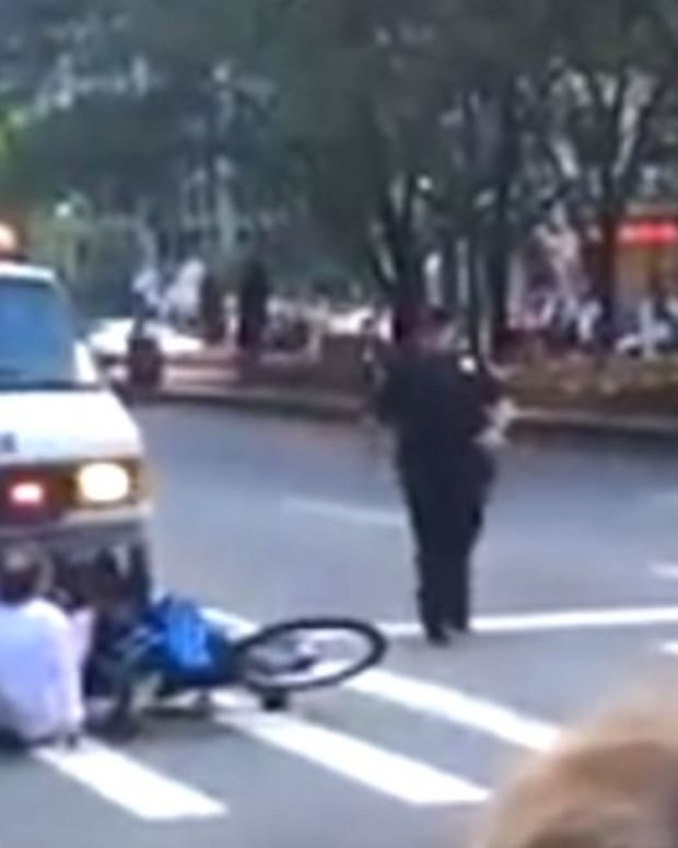 Cops Tackle Cyclist Near Obama's Motorcade (Video) Promo Image