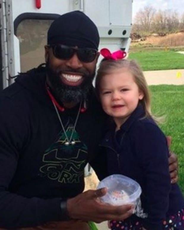 Girl Gives Birthday Cupcake To Favorite Garbage Man Promo Image