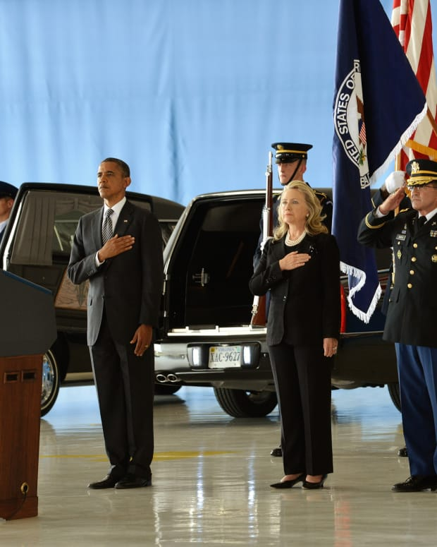 Obama and Clinton at the Transfer of Remains Ceremony for Benghazi victims in 2012.