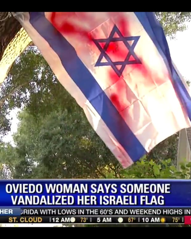 Florida family's Israel flag after it was vandalized