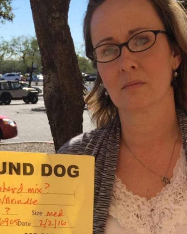 Corinne Stalter holding the MCACC's found dog sign