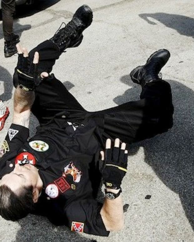 Three People Stabbed During Brawl At KKK Rally  Promo Image