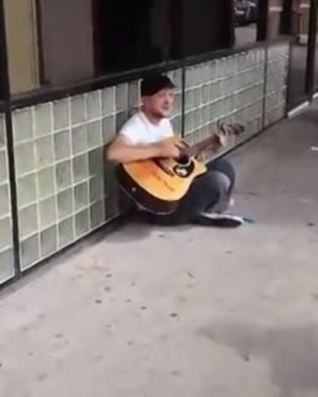 Here's What Happens When These Two Men Interrupt a Street Musician (Video) Promo Image