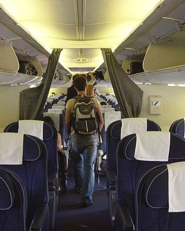 Woman Sues Airline After Being Forced To Move Seats Promo Image