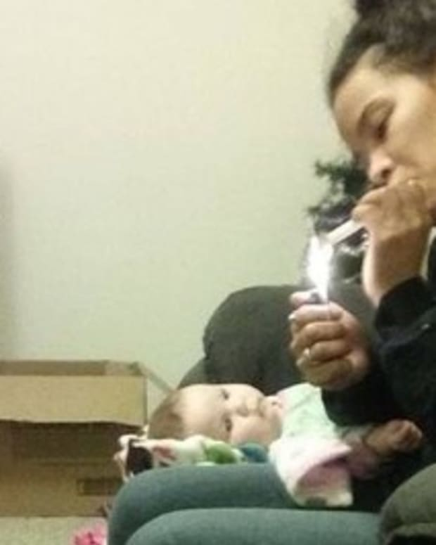 Missouri Mom Arrested For Smoking Meth Next To Baby Promo Image