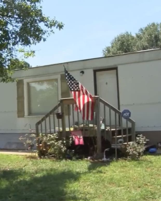 American flag flies outside Teresa Greene's mobile home