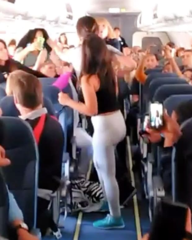 In-Flight Brawl Breaks Out Over Boom Box (Video) Promo Image