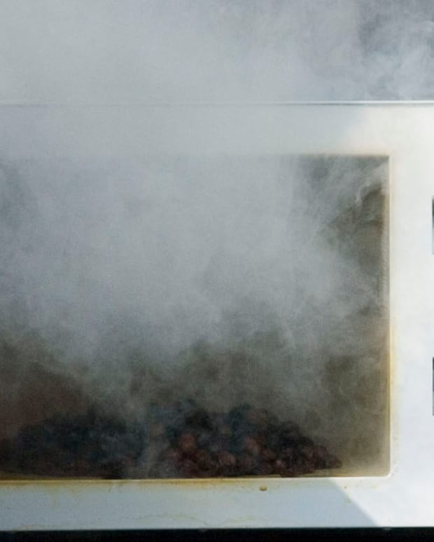 microwave with smoke coming out of it