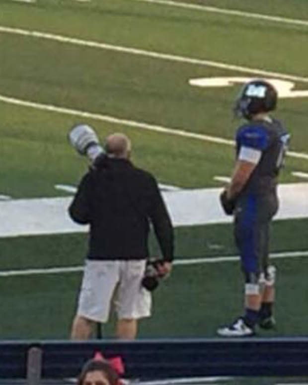 Football Player Stands Alone On Field For Shocking Reason (Photo) Promo Image