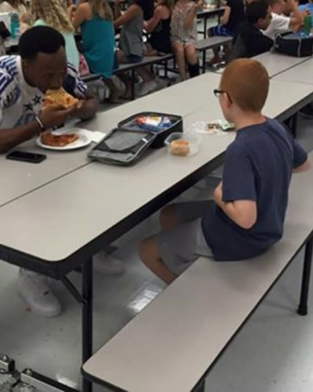 College Football Star Eats Lunch With Autistic Boy Promo Image