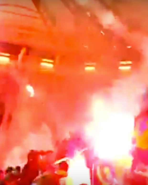 Fans Shoot Flares At Each Other During Soccer Game (Video) Promo Image