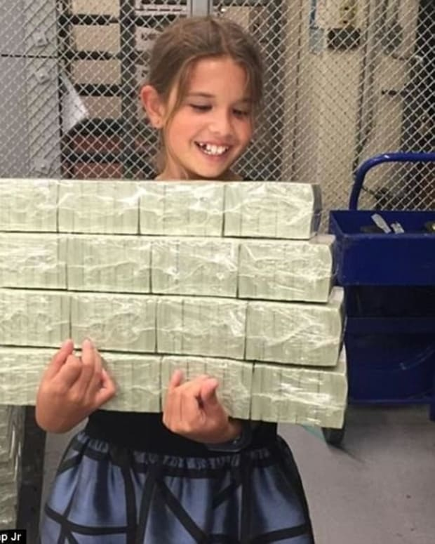 Photo Shows Trump's Grandkid 'Stealing Treasury Money' (Photo) Promo Image