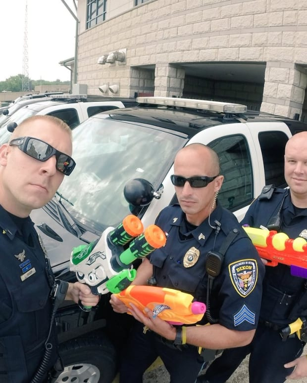 Police Officers Pull Guns On Kids - Water Guns (Video) Promo Image