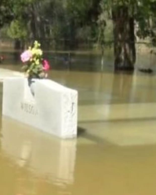 Caskets Float To Surface Amid Deadly Flood Promo Image