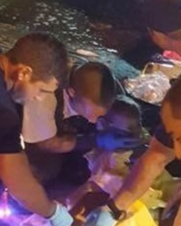 Toddler Found Floating Alive Beneath Capsized Boat (Photos) Promo Image