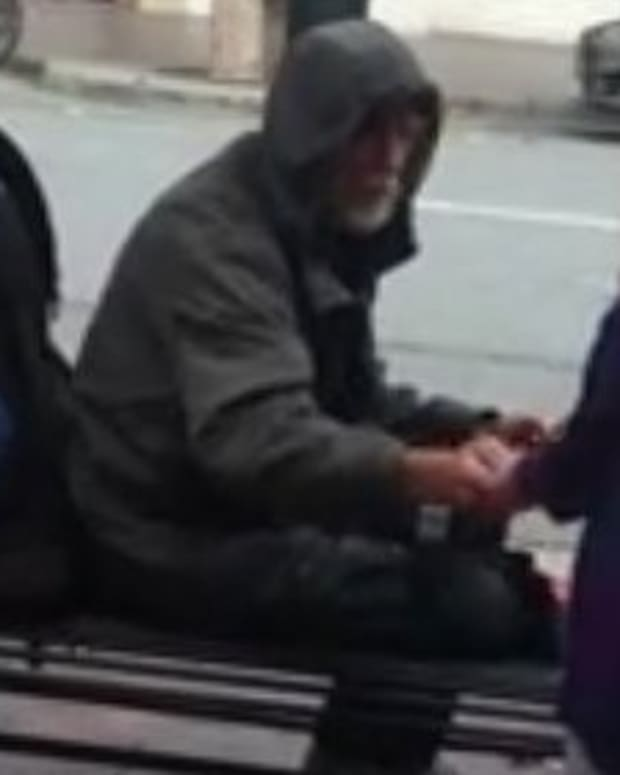 Girl Gives Meal To Homeless Man, Goes Viral (Video) Promo Image