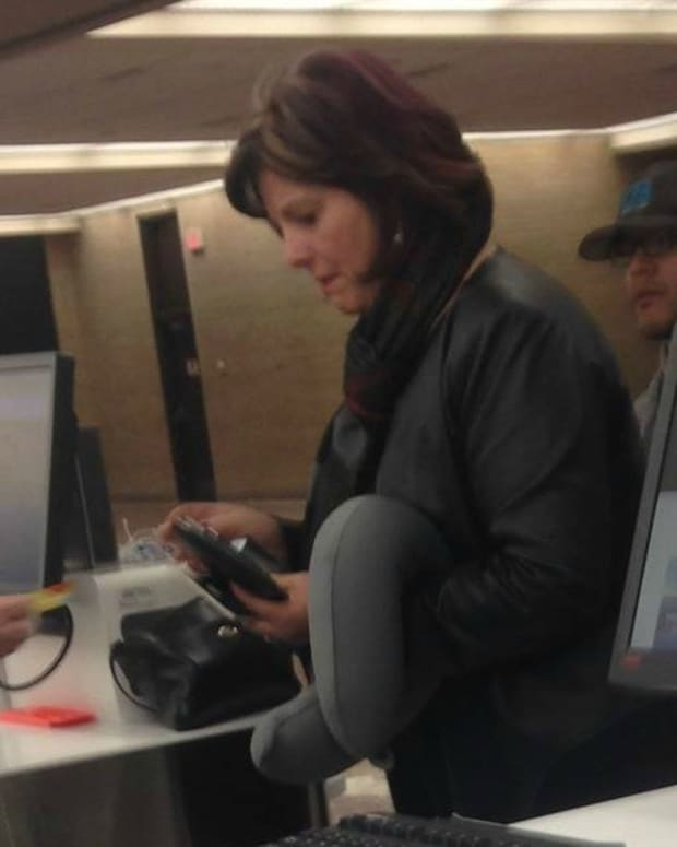 This Picture Of A Woman At An Airport Is Going Viral Promo Image