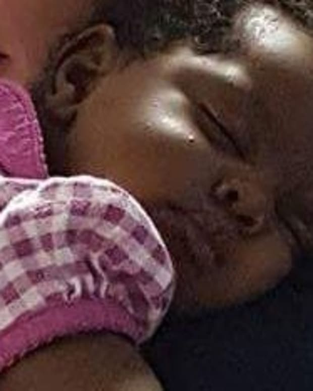 Cop Comforts Baby After Parents Overdose (Photos) Promo Image