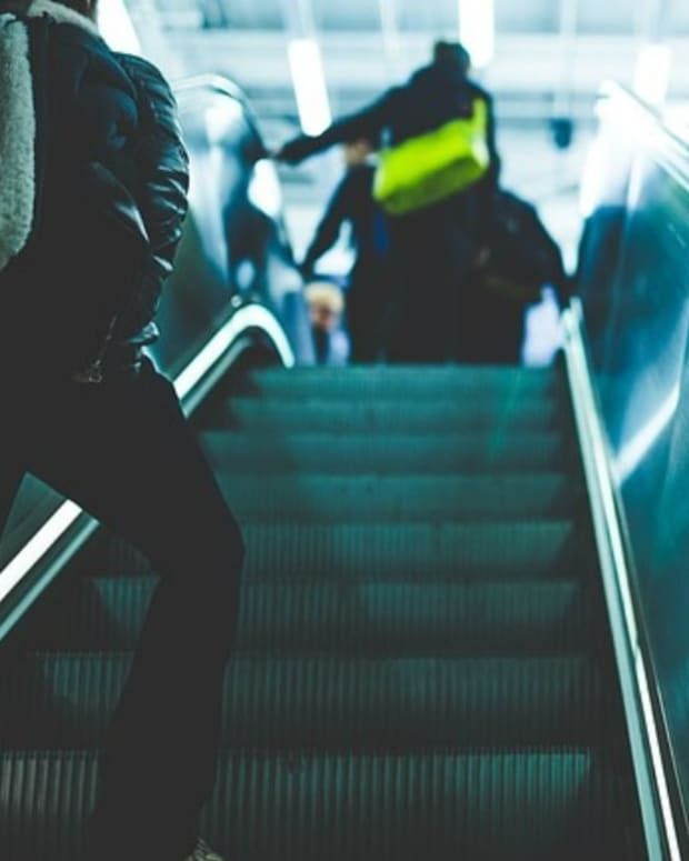 Young Man Helps Elderly Man Down Escalator (Photos) Promo Image