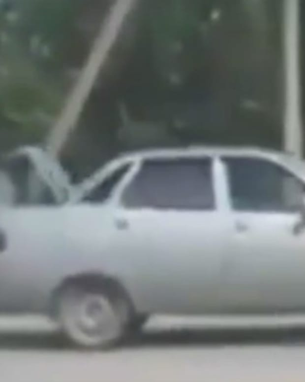 Woman Runs Behind Car, Carries Refrigerator (Video) Promo Image
