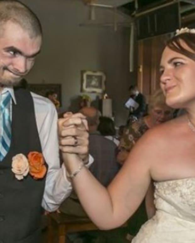 Couple's Wedding Photo Goes Viral For Devastating Reason (Photo) Promo Image