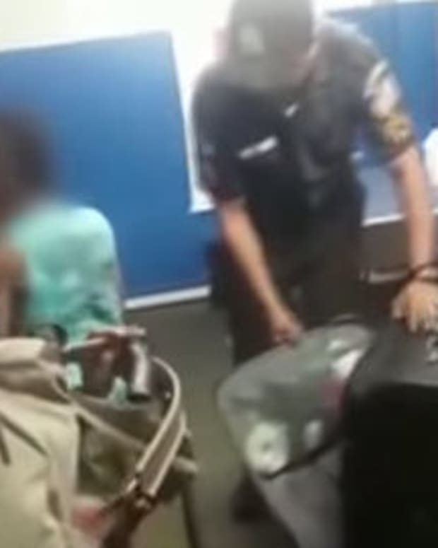 Woman Arrested After Packing Child Into Suitcase (Video) Promo Image