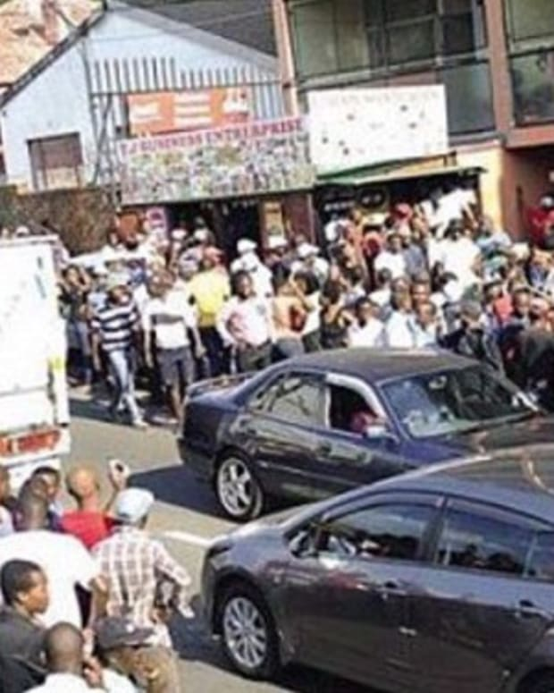 Enormous Crowd Gathers Around Car, Passersby Quickly Figure Out Why Promo Image