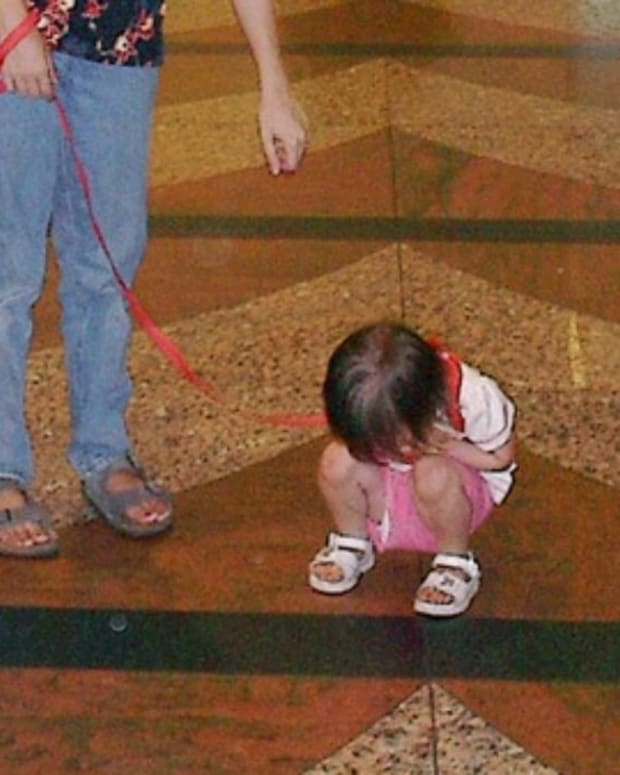 Photo Of Dad With Daughter On Leash Goes Viral (Photo) Promo Image