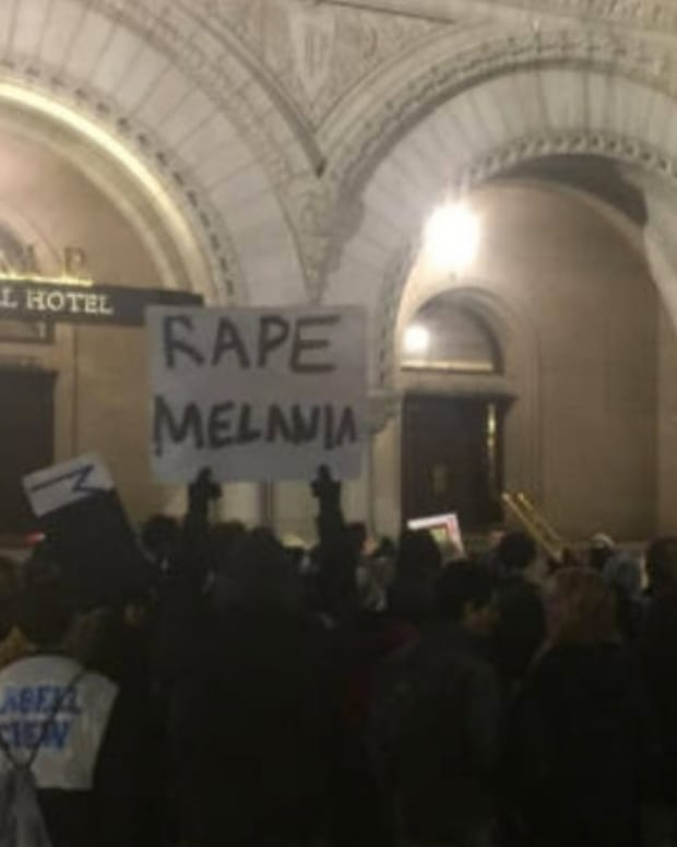 Report: Alt-Right Created Infamous 'Rape Melania' Sign Promo Image