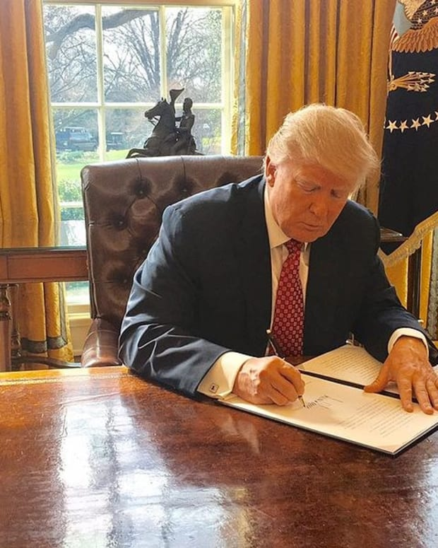 Trump Uses Red Button On Desk For Unusual Reason (Photo) Promo Image