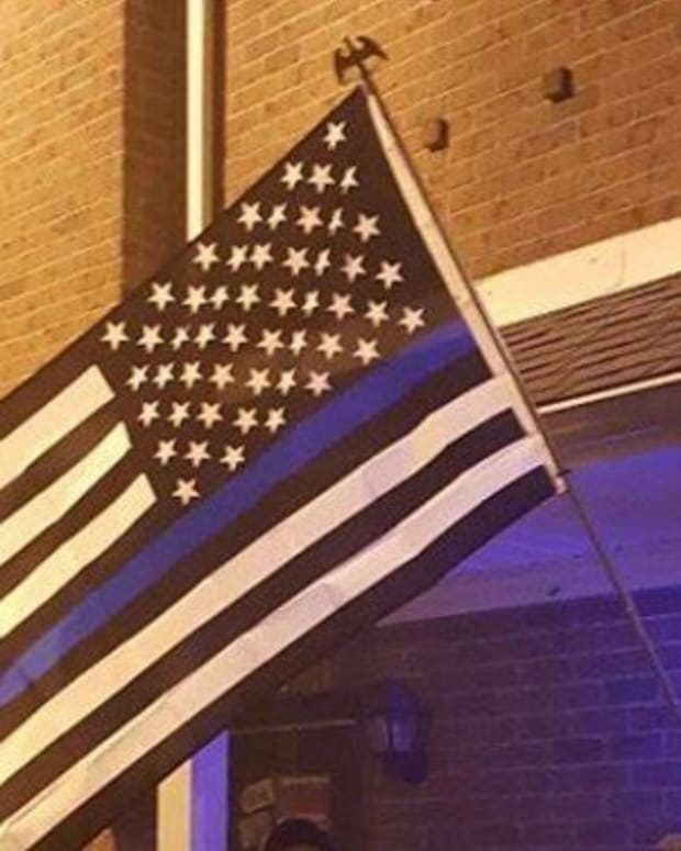 Officers Photograph Student's American Flag, Are Stunned When They Realize What Else Is In The Photo Promo Image