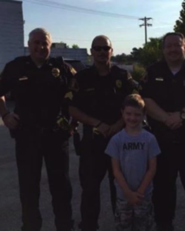Young Boy Picks Up Breakfast Tab for Cops Promo Image