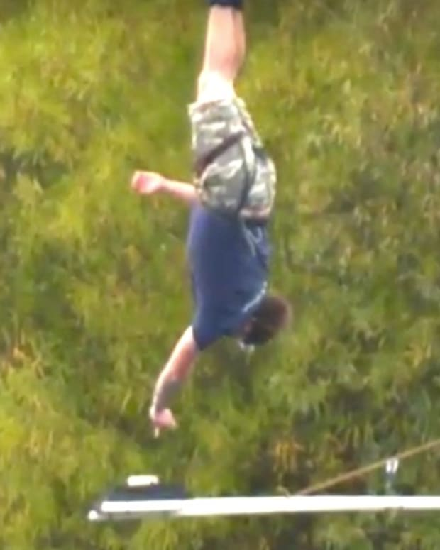 Bungee Jumper Dips Cookie In Tea For World Record (Video) Promo Image