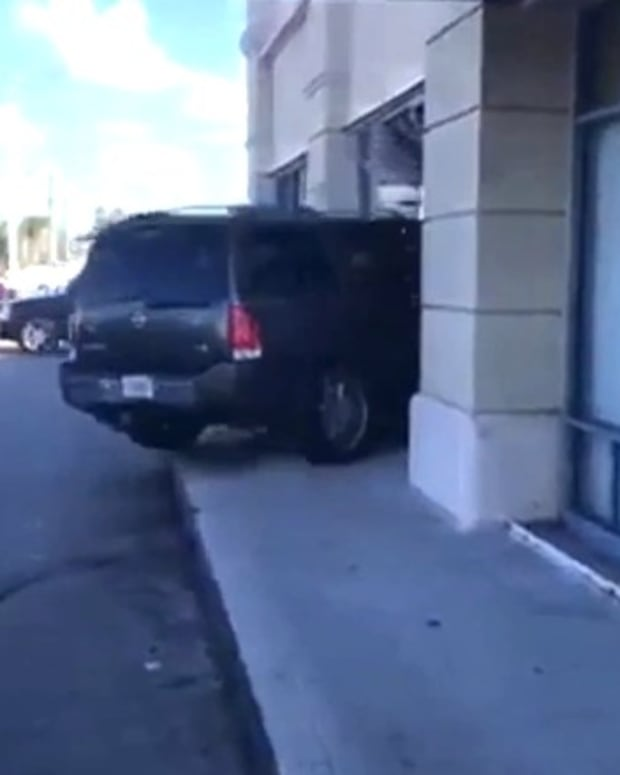 Woman Drives Car Into T-Mobile Store Over Cracked Phone (Video) Promo Image