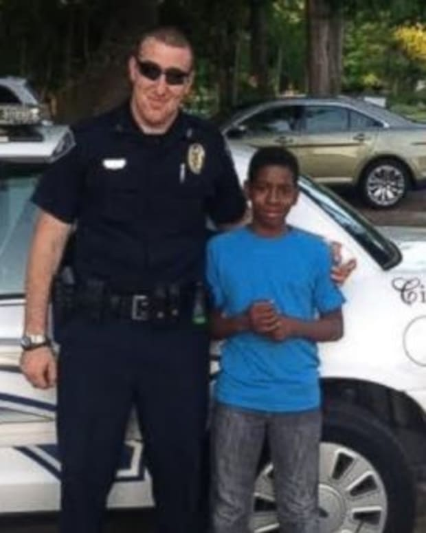 Cop Touches Hearts After Helping Black Teenager (Photos) Promo Image