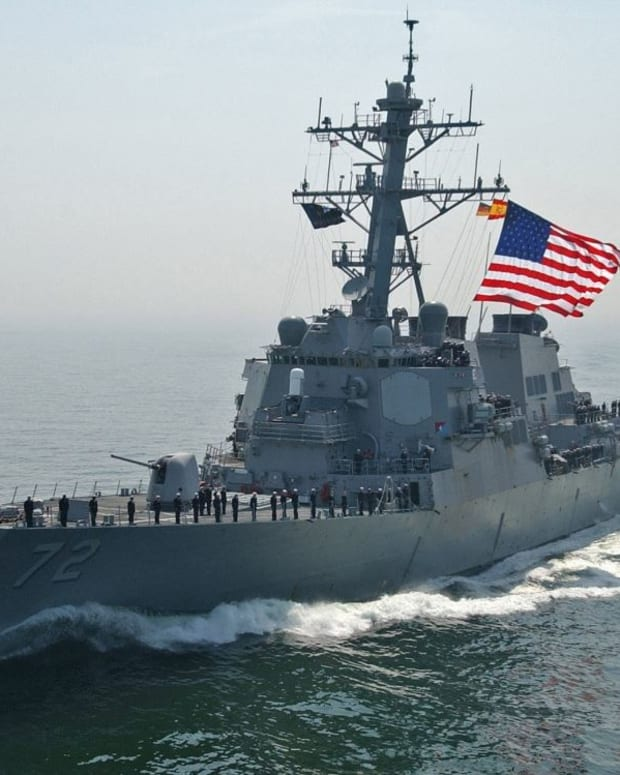 US Navy Destroyer Fires Warning Shots At Iranian Ship Promo Image
