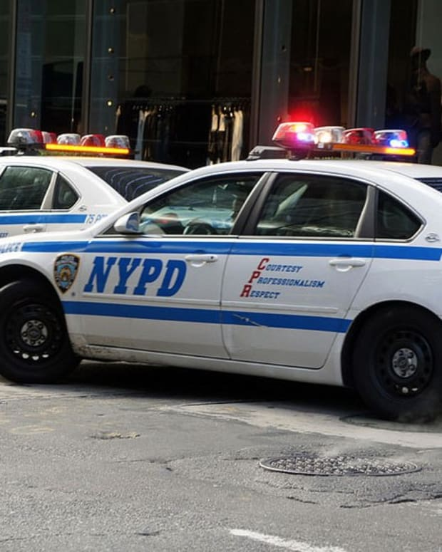 New York Officer Points At Gun At Man Filming Police (Video) Promo Image