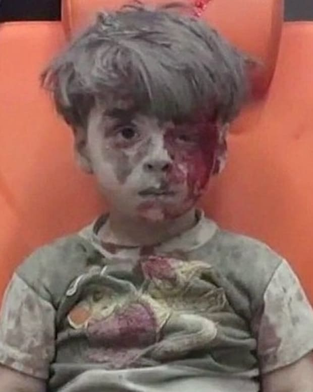 Haunting Images Of Boy In Syrian Civil War (Video) Promo Image