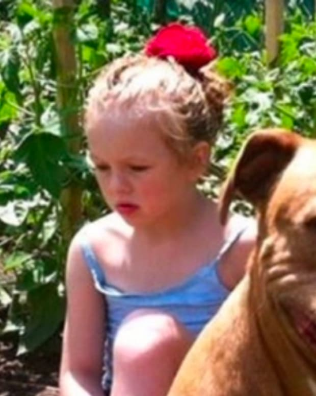 Girl With Autism Becomes Inseparable From Her Pit Bull (Video) Promo Image